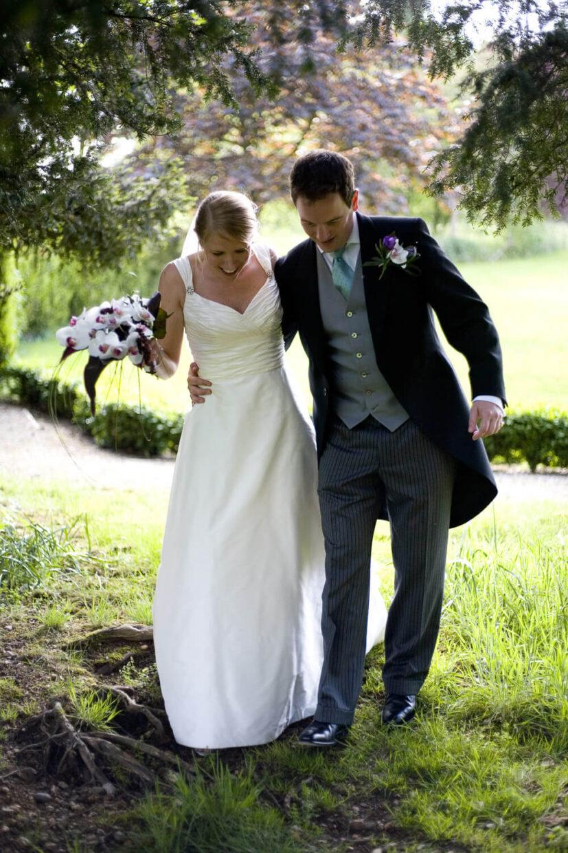 wedding couple walking in woods
