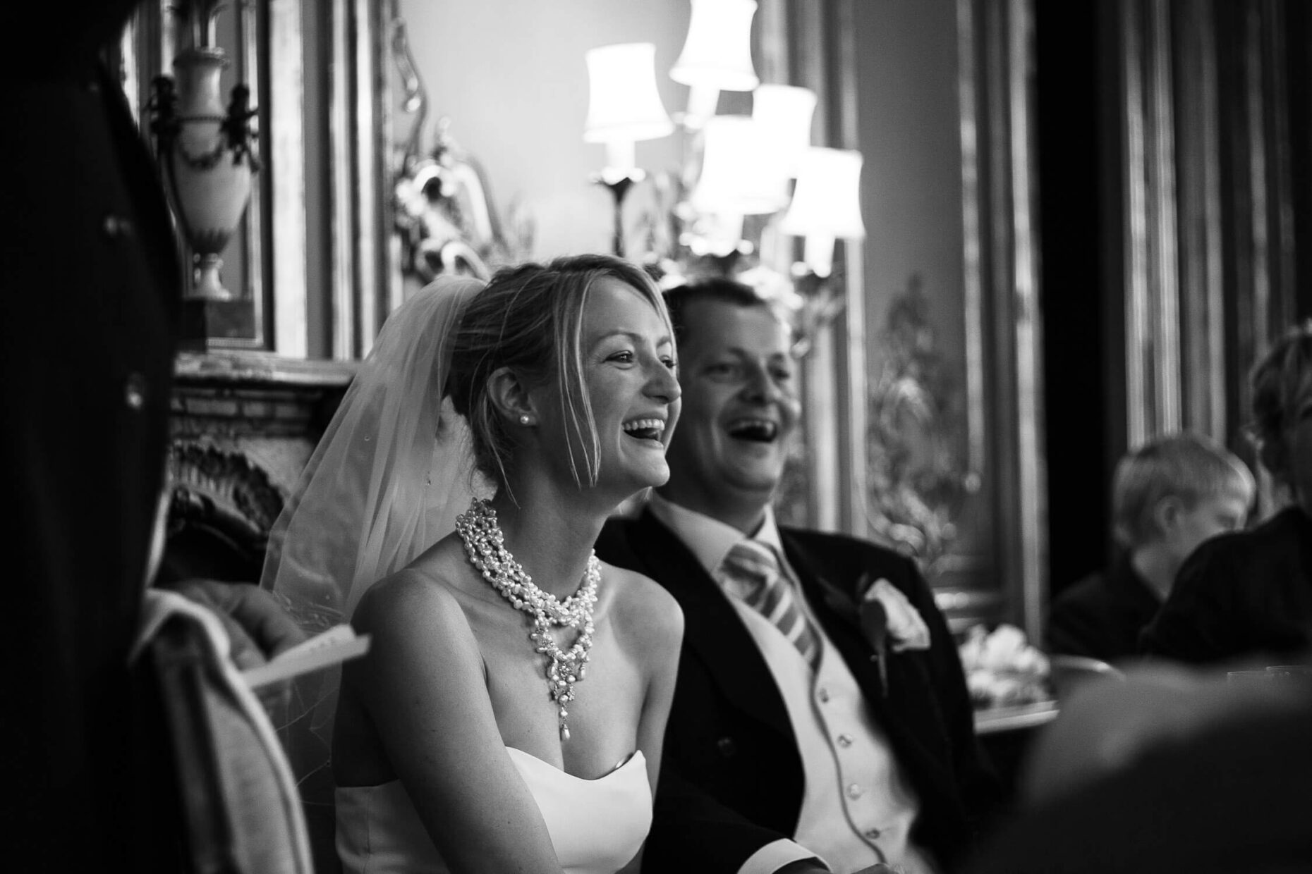 couple laughing in speeches black and white