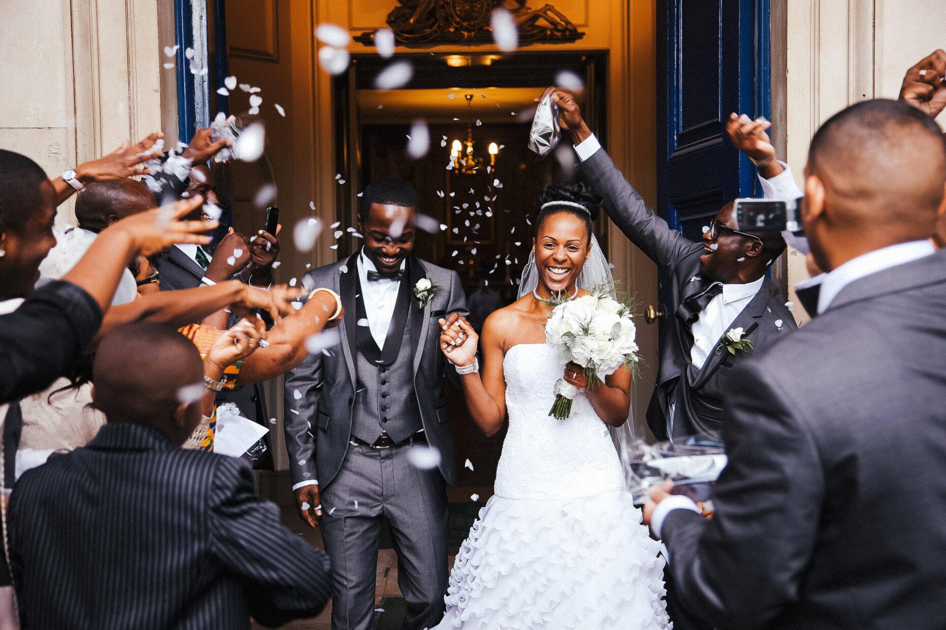 multicultural wedding couple in confetti