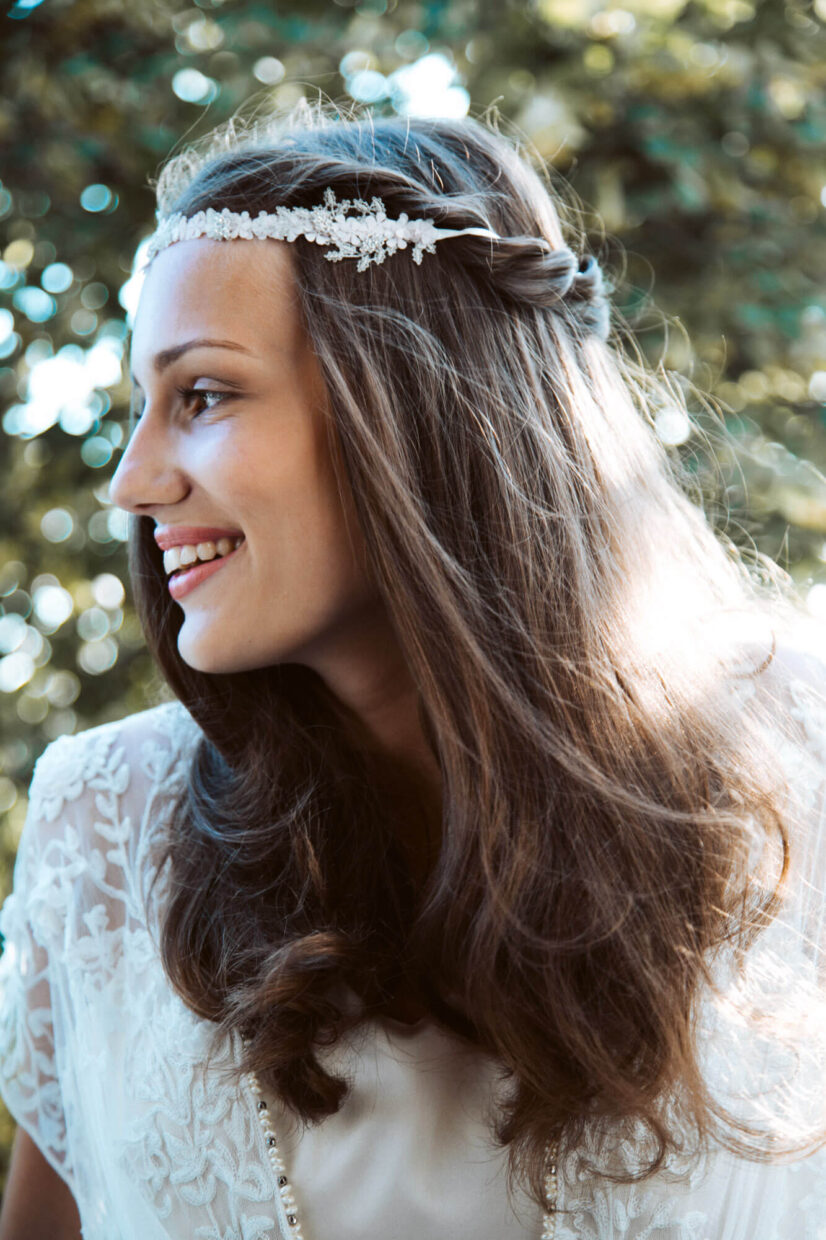 bride looking away with beautiful hair and head crown