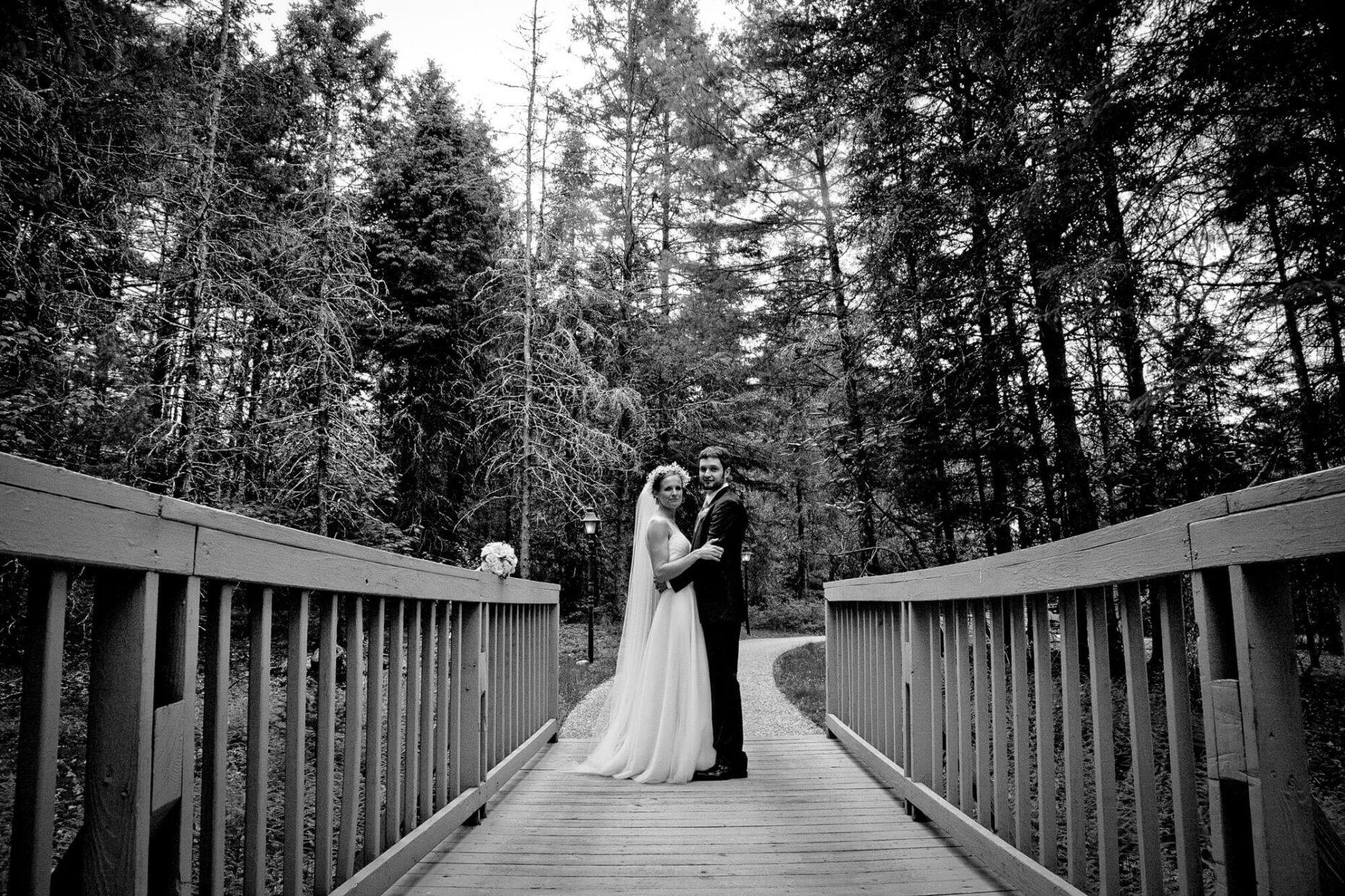 wedding and couple on a bridge in black and white