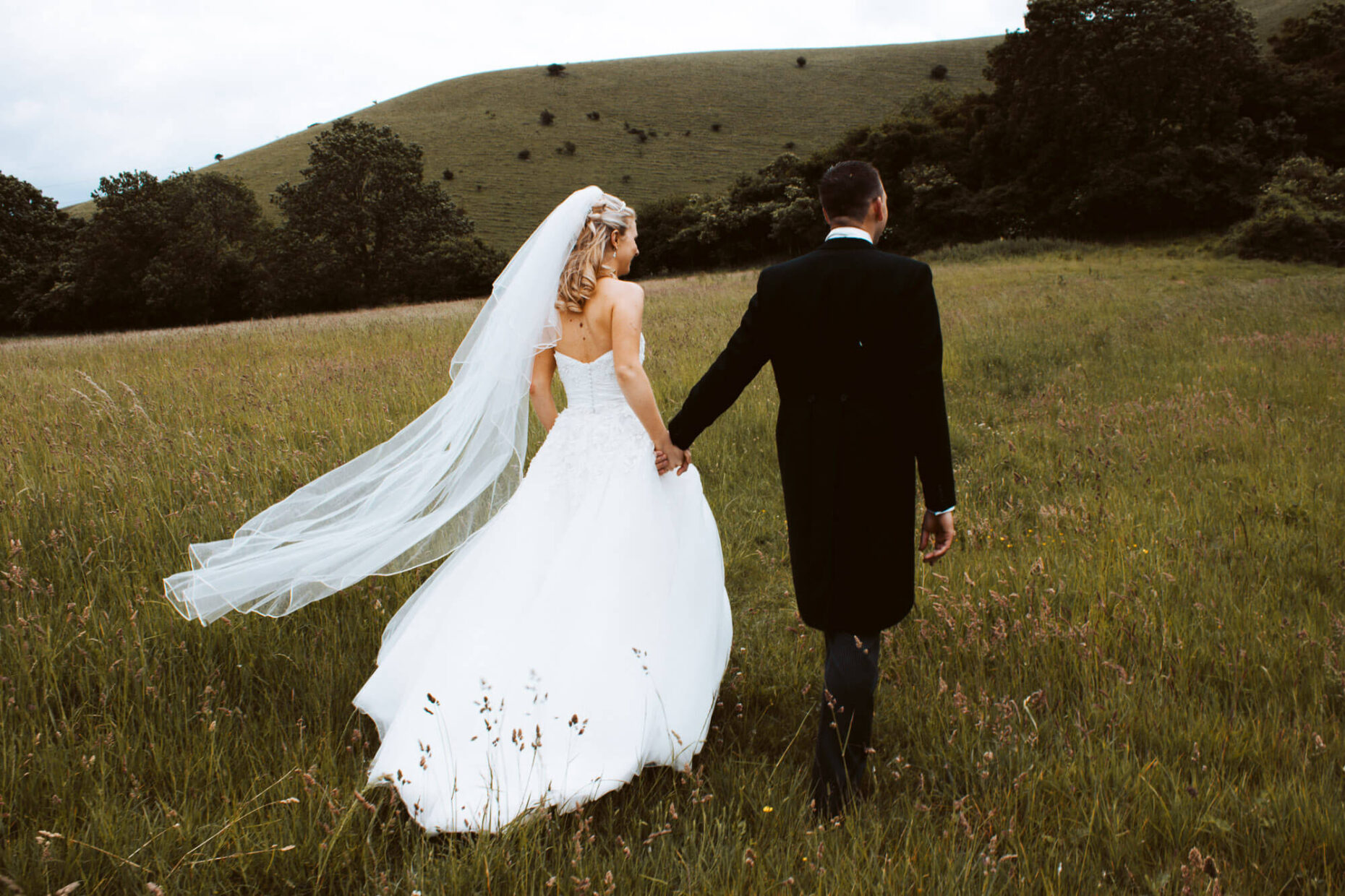 wedding couple walking in field